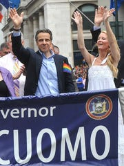 Governor Andrew Cuomo and his girlfriend Sandra Lee walk in the annual Heritage of Pride March, one of the world's oldest and largest gay pride parades, Sunday June 26, 2011, in New York.