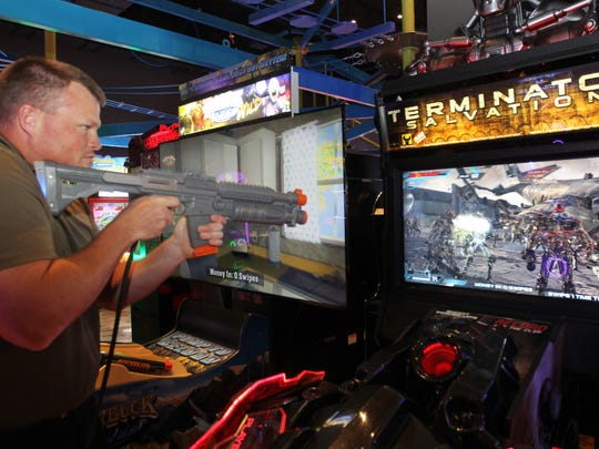 Scott Estridge, who works in West Chester,  plays one of the video games at Main Event Entertainment, West Chester, which held its grand opening 5/24/16.