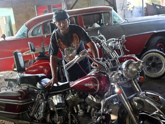 Cuban harlista Antonio Ramirez poses with his 1947 Harley-Davidson in his garage in the municipality of Arroyo Naranjo in Havana on June 22, 2016. (Photo by Ernesto Salazar/Special to the Daily News)