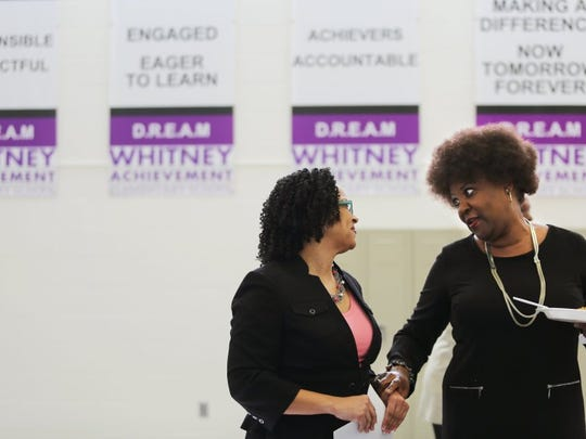 """January 28, 2016 - ASD Superintendent Malika Anderson listens to Sonya H. Smith (right) prior to a Frayser Exchange Club meeting in the gym at Whitney Achievement, one of the schools in the ASD, Thursday afternoon. Smith, a former education chair with the Frayser Neighborhood Council, says she's trying to keep her eye on everything. """"I'm real excited to see what Malika is bringing to the table,"""" says Smith. """"I met with her (previously) and I felt she's authentic."""" (Yalonda M. James/The Commercial Appeal)"""