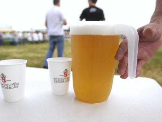 An Ernte-Fest attendee grabs a pitcher of beer.