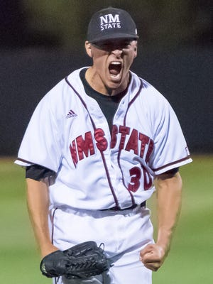 New Mexico State University pitcher Tyler Erwin reacts at the end of an inning against the University of New Mexico on Tuesday, May 3, 2016, at Presley Askew field.