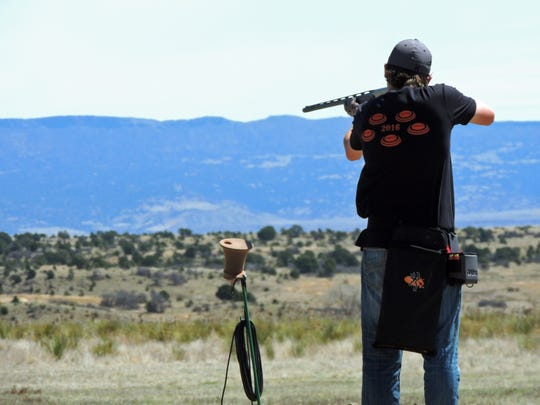 Ian Hull shoots a shotgun at the New Mexico State High