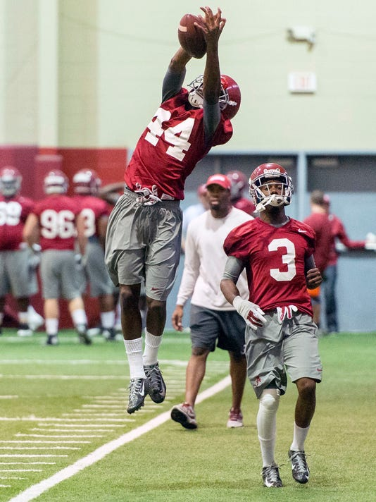 FILE - In this April 16, 2015, file photo, Alabama defensive back Levi Wallace (44) grabs an interception over Alabama defensive back Bradley Sylve (3) during an Alabama spring football practice at the Hank Crisp Indoor Facility in Tuscaloosa, Ala. For all the talk of Alabama's five-star recruits, some unsung guys like converted receiver Anthony Averett and former walk-ons Levi Wallace and Jamey Mosley are also playing key roles. (Vasha Hunt/AL.com via AP, File)
