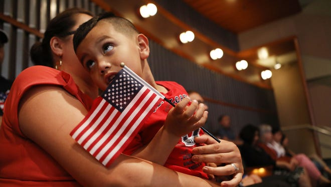 Young U.S. citizen Sergio Montana, 3, originally from Mexico, holds an American flag during a citizenship celebration for young people conducted by U.S. Citizenship and Immigration Services on July 9, 2018 in Los Angeles, California.