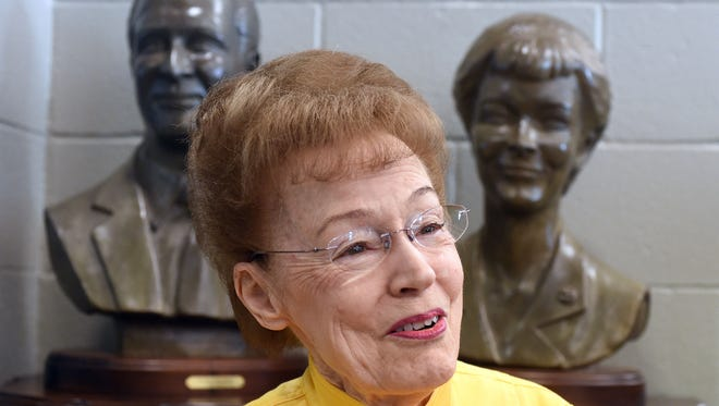 Beloved area educator Evelyn Hackler talks Wednesday about her 39 years in education while sitting in front of bronze busts of herself and late husband Robert at Hackler Intermediate School. The busts, created by renowned local sculptor Ron Moore, are on display in the school's library.