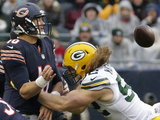 Chicago Bears quarterback Mitchell Trubisky (10) throws an incomplete pass while being pressured by Green Bay Packers outside linebacker Clay Matthews (52) during the third quarter of their game Sunday, November 12, 2017, at Soldier Field.
