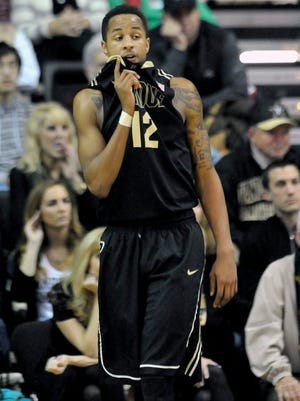 Purdue forward Vince Edwards (12) wipes his face with his shirt during the second half of an 81-71 loss at Vanderbilt.