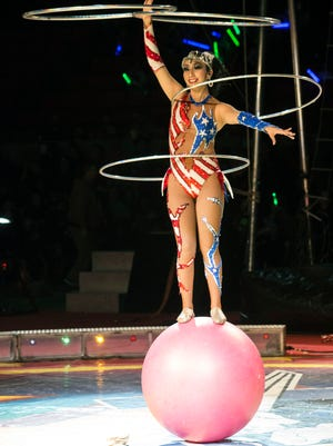 The beautiful and colorful side of The Toscanos Highwire Troupe displayed multitasking balance closer to the ground during the Kosair Shrine Circus on Friday morning. 2/6/15