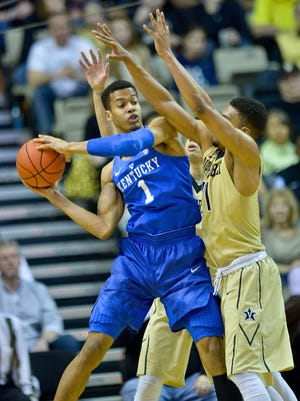 Feb 27, 2016; Nashville, TN, USA; Kentucky Wildcats forward Skal Labissiere (1) looks to pass against Vanderbilt Commodores forward Jeff Roberson (11) during the first half at Memorial Gym. Mandatory Credit: Jim Brown-USA TODAY Sports