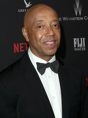Russell Simmons was hit with a $5 million lawsuit Wednesday from a woman alleging he raped her in 2016.