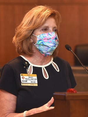 Mary Beck, chief nursing officer at University of Missouri Health Care, talks to the media about the COVID-19 pandemic Tuesday during a press conference at City Hall.