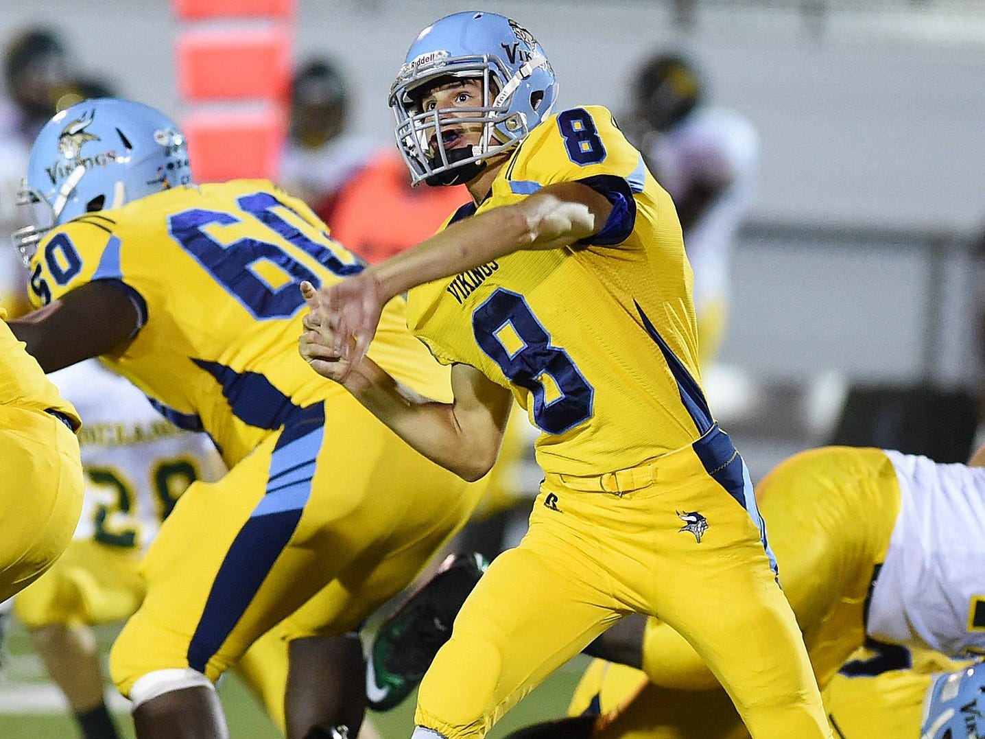 Cape quarterback #8 Dillon Adams fires a pass as Cape Henlopen (yellow) hosted Indian River (white) on Friday night.