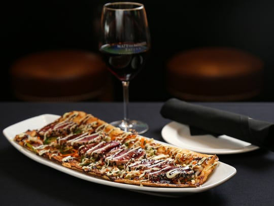 Ahi Tuna flatbread, prepared with miso mouse, topped