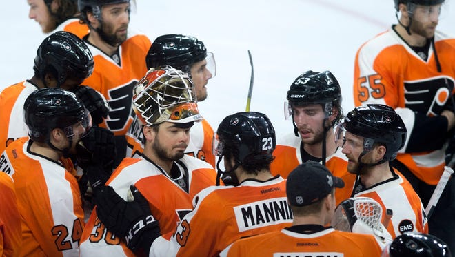 Flyers' Brandon Manning (23) speaks with goalie Michal Neuvirth (30) after a 1-0 loss to Washington in game 6 Sunday, April 24 in Philadelphia. Neuvirth made a total of 28 saves in the game.