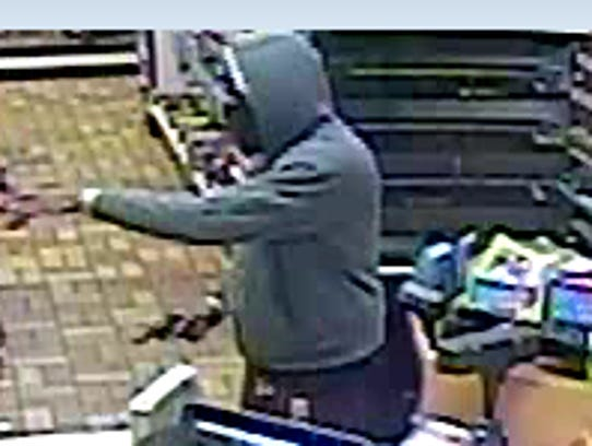 The armed suspect is shown robbing a Speedway store early Saturday morning in Waynesboro on East Main Street.