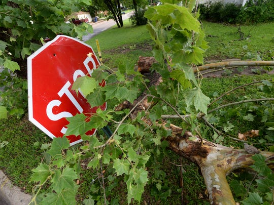 A tree branch blocks this stop sign on East Ratcliff Street in Shreveport following heavy winds and the report of a tornado in the Shreveport area Monday evening.
