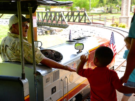 Conductor Bob Callihan gives a young passenger a high-five as he gets off the Gypsy Hill Express on Sunday, June 21, 2015.