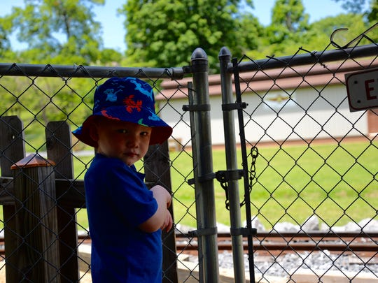 Tyler Simmons, 3, waits for the Gypsy Hill Express on Sunday, June 21, 2015.