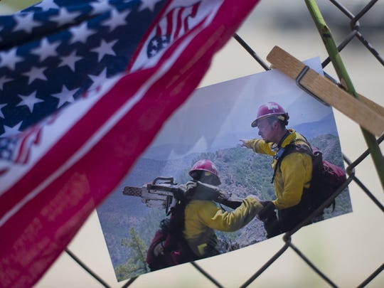 A photo of the Granite Mountain Hotshots at work is