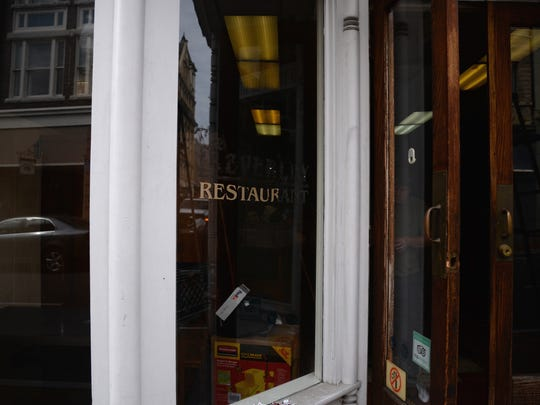 Only bits of lettering of the Beverley Restaurant remain