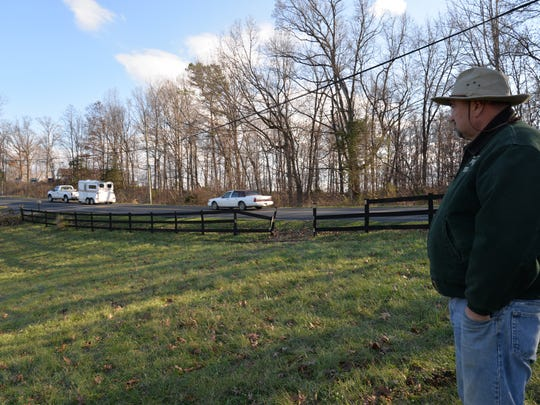John Liskey looks at the portion of his fence where a car first entered off Fadley Road in Weyers Cave into a field with four horses. One horse was hit and was later put down due to his injuries.