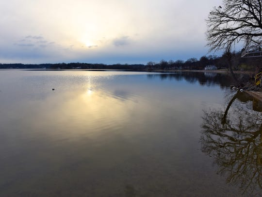 The sun sets Tuesday, Dec. 8 over Lake Koronis in Paynesville