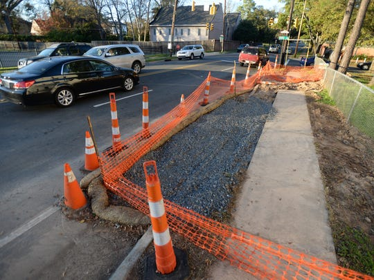Motorists pass a section of road under construction on Line Avenue at Ockley Drive.