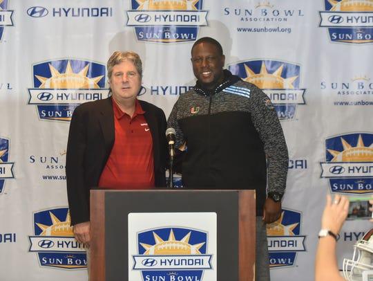 Washington State coach Mike Leach, left, and Miami