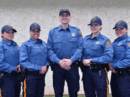 L to r:  New Vineland officers Meaghan Pagan,23,  Jasmine DeLatorre,25, Tony Pierro,26, Kimberly Beu,24, and Amanda Rivera,23, in training at the Vineland Police Training Center.  Dec. 17, 2015