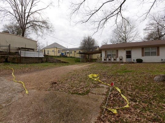 The home of accused killer Jermaine Johnson and the yellow house of victim Sulyn Prince in the distance. Jermaine Johnson had recently been released from prison for rape.