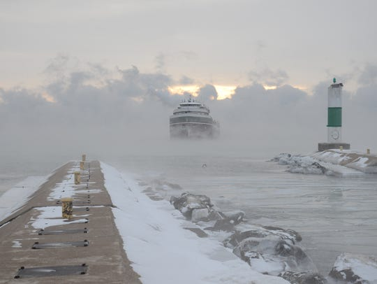 The Wilfred Sykes emerges from the fog on its way to