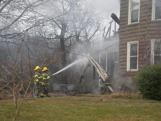 Firefighters at the scene of a fire that destroyed