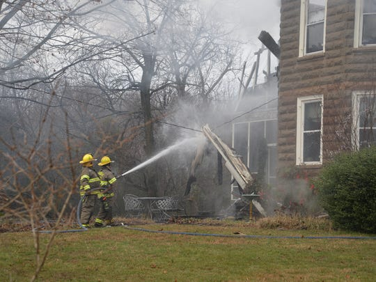 Firefighters at the scene of a fire that destroyed a Verona home on Sunday, Jan. 17, 2016.