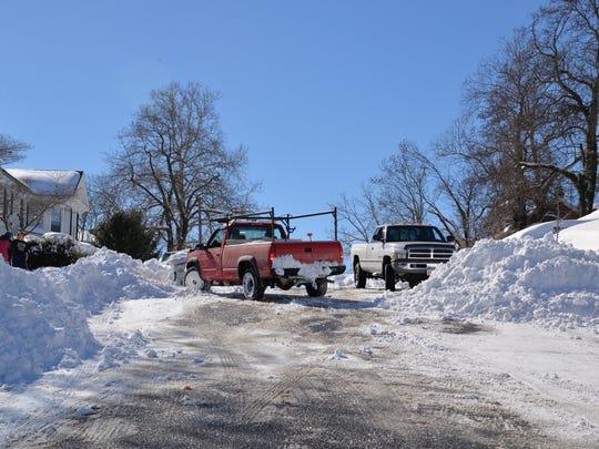 A truck plow takes to Walnut Avenue in Waynesboro on Sunday, Jan. 24, 2016.