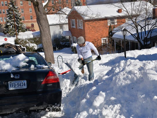 David Hadwin digs out his car on Walnut Avenue on Sunday,