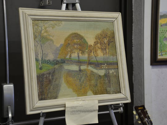 A Grandma Moses painting that went for $5,700 at the Bennett Auction at Augusta Expo on Sunday, Jan. 31, 2016.