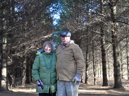 Diana and Ken Brasfield at their tree farm in Middlebrook.