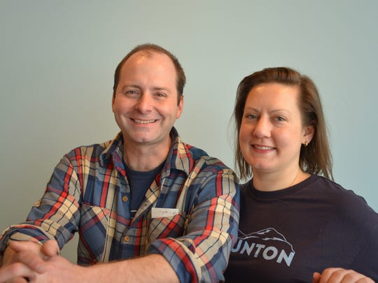 Katie McCaskey and husband, Brian Wiedemann, outside of their new food to-go store on New Street in Staunton.