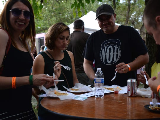 Katie Reinhardt, center, brought family and friends from out-of-state to the Food Truck Battle. Put on by The Madee Project, which helps families and children with pediatric cancer, the fundraising event gathered 12 trucks and multiple local beer and wine participants to the battle in 2015 at the Frontier Culture Museum.