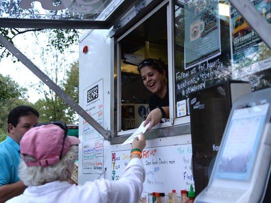Rocktown Slops serves up food at the Food Truck Battle. Put on by The Madee Project, which helps families and children with pediatric cancer, the fundraising event gathered 12 trucks and multiple local beer and wine participants to the battle in 2015 at the Frontier Culture Museum.