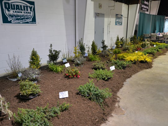 A display by Quality Lawn Care at the Home and Garden