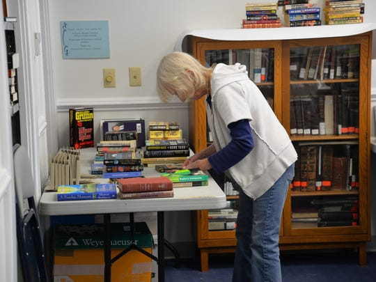 Volunteers gear up for the biannual book sale at the
