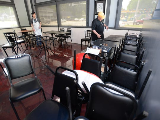 Staff begin the task of arranging tables in one of the dining areas of Blue Southern Comfort Food and Ice Cream Parlor.