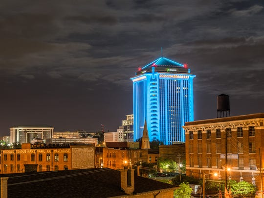 The RSA building is illuminated in downtown Montgomery