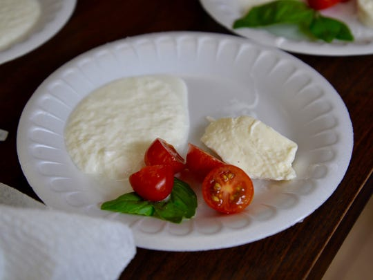 Freshly made mozzarella and ricotta cheese with fresh tomato and basil.