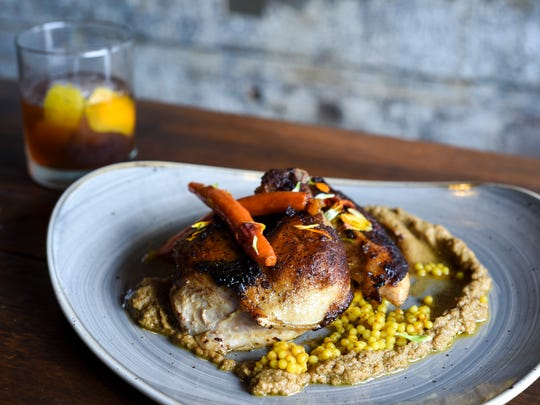 The Moroccan chicken served with an Old-Fashioned.