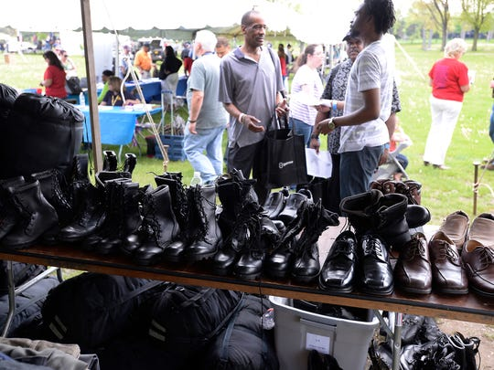 Boots and shoes await veterans at the 11th annual Stand Down for Homeless Veterans at Adado Riverfront Park, May 21, 2014.