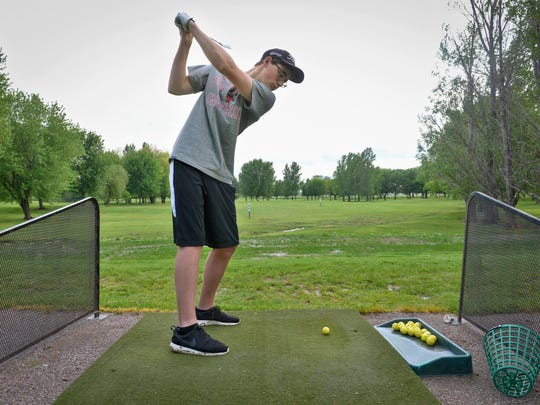 Albany High School senior David Schneider practices a drive on the range Wednesday, May 25, 2016, at the Albany Golf Club. Schneider is the Times All-Area Boys Golf Player of the Year.