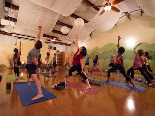 Asheville Community Yoga will dim the lights on Dec. 16 for a black light glow yoga session.